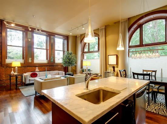 Beyond The Custom Designed Kitchen Is A Spacious Dining Room With A Gas  Fireplace Leading To A Grand Terrace Offering Spectacular City Views.