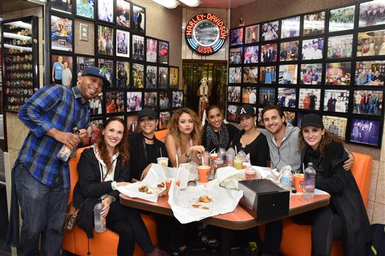 Almost Angels enjoy Geno's Cheesesteaks at the celebrity booth.